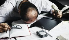 man-with-head-down-on-desk